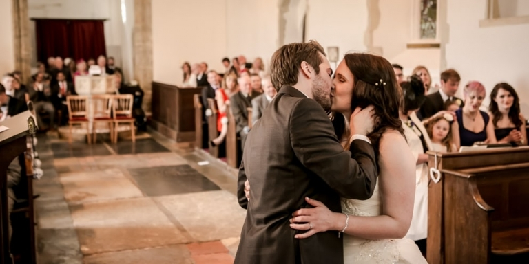 Married-couple-kissing-in-church